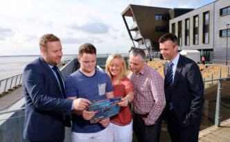 The first student to apply to join the Ron Dearing UTC, Lewis Speedy, with parents Jason and Wendy and UTC Vice Principals Steve Willacy, left, and Mark Ollerenshaw at Hull's new open-air amphitheatre.